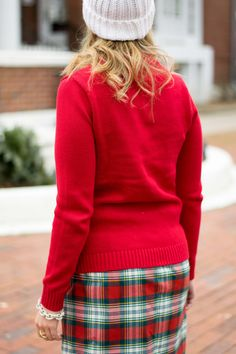 Holiday outfit idea by Emillion Thoughts // red mock neck sweater, cable knit sweater, Christmas outfit ideas, plaid skirt, J. Crew Factory style, holiday style, holiday fashion, holiday look, Christmas style, pom beanie, Old Navy style, Land's End sweater, Hunter boots, green Hunter boots, wreath, how to style Hunter boots for the holidays