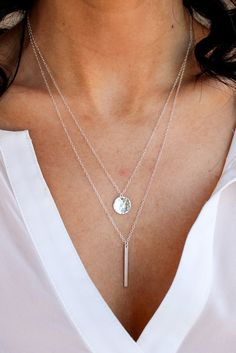 A small Sterling Silver circle is hand hammered creating shimmering marks that catch the light! This minimal and luxe design is on a delicate Sterling Silver chain. Perfect for layering, collect it fo