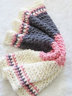 If you love working with the squishy Bernat Blanket yarn, you will love this quick and easy crochet afghan that works up in just 5 hours. This free crochet pattern is designed using a variation of the single crochet stitch that adds texture to your chunky blanket. This is a beginner friendly pattern perfect for making quick gifts. #bernatblanketyarnpattern, #crochetafghan, #crochetblanket, #freecrochetblanket, #crochetbabyblanket