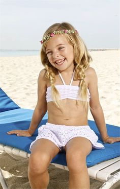 Little Peixoto Designer Beach Shorts - The Peixoto Kids Shorts are cut from the best quality fabric in Colombia. All Peixoto Kids swimwear can be paired with these Designer Kids White Crochet Shorts to create the ultimate beach day look. Their loose fit and beautiful fabric make sure your girl will be both comfortable and fabulous for any beach day. #peixoto