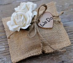 "Wedding Ring Pillow Rustic Wedding, Rustic Ring Wedding Pillow Cream Paper Roses, Personalized ""We Do"", Shabby Chic Weddings. $37.99, via Etsy."