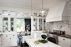 Add Modern Kitchen Lighting to your Interior Design : Modern Kitchen Lighting Over Island. Modern kitchen lighting over island. Kitchen Ikea, White Kitchen Cabinets, New Kitchen, Kitchen Dining, Kitchen Decor, Glass Cabinets, Dining Room, Family Kitchen, Glass Shelves
