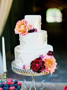 Wedding Cake with Gold Leaf and Bright Flowers