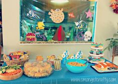 Finding Nemo Party | C'mon Get Crafty. LOVE that she turned this space into the aquarium from Finding Nemo :)