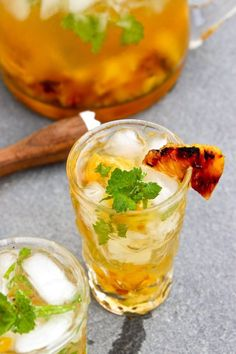 Grilled Pineapple Mojito - Mint Simple Syrup, Grilled pineapple, Lime Juice, Light Rum, Club Soda.