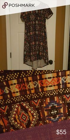Hard to Find Aztec Printed XS Lularoe Carly NWOT This beautiful multi colored XS Lularoe Carly has a black background. Perfect statement piece for any wardrobe. NWOT LuLaRoe Dresses High Low
