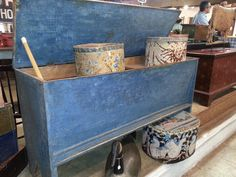 This is an old dough box with divided interior with the best blue paint