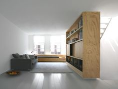 Wooden shelves as space separation. Home 01 by Dutch office i29.