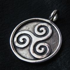 Silver Triskelion pendant from The Sunken City by DaWanda.com