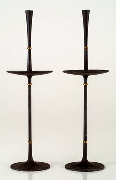 Jens Quistgaard; Cast Iron and Brass Candle Holders for Dansk, 1950s.
