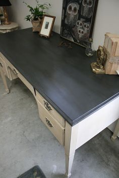 Woah! Spray painted graphite chalk board paint.... BUT... Dark waxed afterwards! Gives a solid slate kind of look.