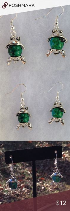 Green Chrysocolla Frog Earrings These beautiful earrings are made with natural chrysocolla that has been color treated. The hooks are sterling silver plated.   All PeaceFrog jewelry items are handmade by me! Take a look through my boutique for coordinating jewelry and more unique creations. PeaceFrog Jewelry Earrings