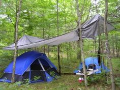 Camping in the rain is not exactly fun, BUT having an extra large tarp sure would make it a bit easier!
