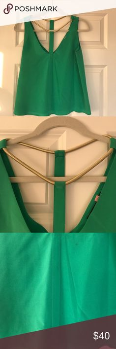 BCBGMaxazria top Cute green top - worn once, still have dry cleaning tags attached. There are a few marks (see photo) BCBGMaxAzria Tops Blouses