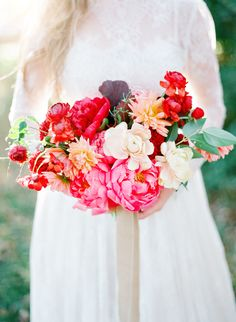 Bold & Beautiful Bouquet with Red Charm & Coral Sunset Peonies from Reverie Made on SMP. See the full list here: http://www.StyleMePretty.com/2016/04/30/bouquet-breakdown-rustic-bohemian-bridal-inspiration/ Kay English Photography