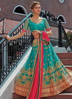 Turquoise Magneta Embroidery Work Net Chiffon Wedding Designer Lehenga Choli http://www.angelnx.com/Lehenga-Choli/Wedding-Lehenga-Choli