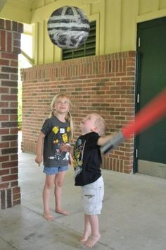 papier-mâché deathstar + pool noodles, duct tape & electrical tape = a pinata, & cheap, safe lightsabers for taking it down!