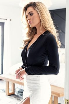 The Cross My Heart Black Bodysuit is what every babe needs! This bodysuit features a plunging surplice bodice, soft jersey knit material and an attached thong bottom. Pair with one of our new skirts and fave stilettos for a stunning look for any occasion.