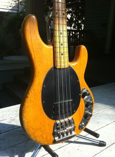 """1978 Music Man Stingray -  One of mine and a very early example, with masses of 'character'..Sure, it looks like crap, but it sounds fantastic! Who needs fancy 'relic finishes', when you have 40 odd years of hard play....The sharp of eye will notice what remains of the rubber """"muting pads"""", just behind the knurled knobs at the top of the bridge - needless to say, I don't know anyone who ever used them...on full song, this will cut through about anything....K"""