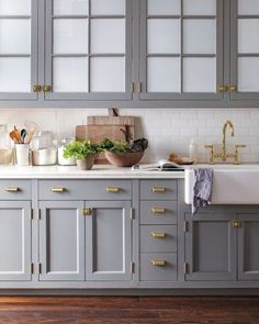 elegant grey and gold kitchen cabinets