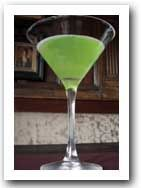 EMERALD ISLE MARTINI  Ingredients: (for one drink)  2 oz. gin or vodka  1 oz. simple syrup  1 sprig mint  1 drop green food coloring