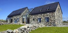 Stone House designed by Peter Legge Associates ;-Stone House designed by Peter Legge Associates ; Connemara / Ireland Stone House designed by Peter Legge Associates ; Stone Cottages, Stone Houses, Glass Houses, Farmhouse Plans, Modern Farmhouse, Modern Cottage, Cottage Extension, Beach Houses For Rent, Design Exterior