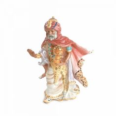 """The Nativity Nubian Wise Man is a Christmas classic! This beautiful Nativity Collection captures the true reason for the season! Our stunning ceramic Nativity Figurines create a breathtaking family holiday tradition. The Nativity Nubian Wise Man Figurine kneels to offer his gift and is 9 3/8"""" high."""
