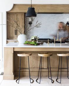 Dana Wolter Interiors - white hard surfaces, wooden cabinetry, black accessories - kitchen