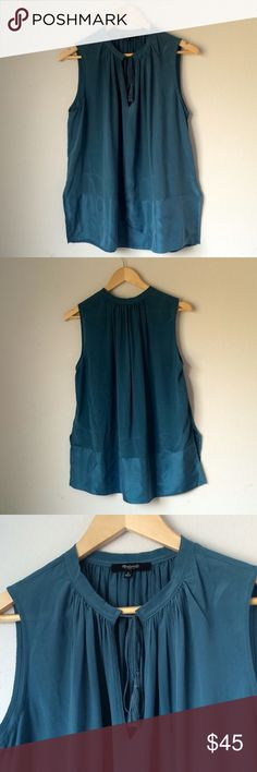 Madewell Sleeveless Dark Teal Tunic ACCEPTING OFFERS!!. No low ballers. No trades. Used but excellent condition. Size small but slightly oversized. 100% SILK. Cute with leggings/jeans and flats/booties/knee high boots. Or dress up for work with slacks/skirt and heels. Retail $102 Madewell Tops Tunics
