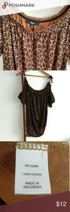 Stalking Animal Print Top *Design by Express  *X-small  *Stylish Animal print that styles well with your jeans  *This top has a subtle sexiness  *It has a conservative neckline but arm slits making it easily wearable  straight from work to a night out  *It's covered in shimmer fits that reflect the light  *Arm to arm 18 inches  *Sleeves 9 inches long  *Top to bottom 21 inches  *Normal wear Express Tops