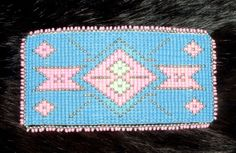 """A large 4.5 x 2.5"""" beaded barrette in light pink and baby blue. Beadwork is sewn to a leather backing.  Metal french clip snap clasp closure Native American made. A one of a kind piece! $60.00 w/ free shipping #beaded #barrette #nativeamerican"""