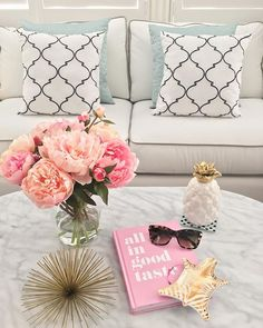 Currently on my coffee table: favorite sunglasses, book, flowers and gold accents. If you have a small face, I would highly recommend these sunnies - they are perfection.  Shop these items via @liketoknow.it or type this exact link in your browser  www.liketk.it/21WLO #liketkit @katespadeny #livecolorfully #katespade #ltkhome