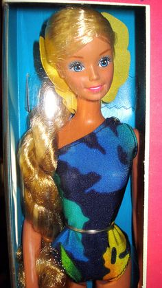 Barbie - Tropical Barbie, 1980s. I distinctly remember that bathing suit being in my barbies closet.