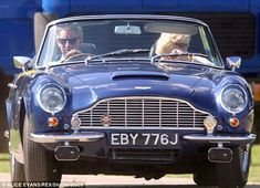 Prince Charles and the Duchess of Cornwall in an Aston Martin Volante at a polo game in 20...