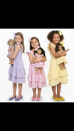 Dollie and Me outfits with the Girls and their beautiful American Girl Doll's.  How cute?