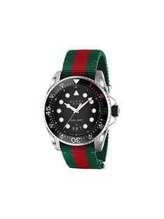 Permanent CollectionGucci Gucci Dive watchGucci brings a new definition to luxury in the 21st century. The label is renowned for their expert Italian craftsmanship, attention to detail and romantic aesthetic. This green Gucci Dive watch features a stainless steel case, a round face, a black matte dial, a green and red Web fabric strap, quartz movement and a pin buckle fasteningMade in Italy Compositionstainless steel 100%, Nylon 100%Designer Style ID: 561680I1820 Gucci brings a new… Big Watches, Best Watches For Men, Luxury Watches, Cool Watches, Rolex Watches, Popular Watches, Checkerboard Pattern, Elegant Watches, Gucci Handbags
