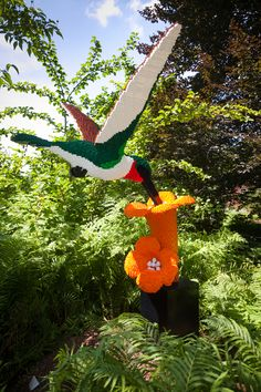 That's some hummingbird! Created by Sean Kenney, the world's first Lego® Certified Professional. Table Games, Hummingbird, Lego, Create, Outdoor Decor, Home Decor, Board Games, Decoration Home, Room Decor