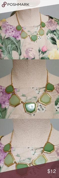 "Gold Pale Green Geometric Statement Necklace Great statement necklace with a floral dress!  From JCPenny.  Has been worn often but still looks great.  Gold tone metal, claw clasp with extender, sparkling rhinestone accents around the five large 'jewels'.  Two shades of pale green- one is more mint green.  Geometric shapes, the 'jewels' look acrylic.  Is 17"" long with 2.5"" extender to adjust the fit depending on the neckline of your dress or top. jcpenney Jewelry Necklaces"