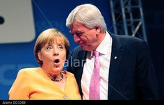 Wiesbaden, Germany. 24th Aug, 2013. German chancellor Angela Merkel and Volker Bouffier stand onstage during a CDU election campaign event Credit: DANIEL REINHARDT/dpa/Alamy Live News