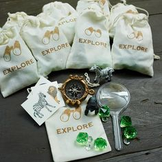 Each P.S. XO Safari party favor comes with gems, a compass, animal figurines, a magnifying glass, and three tattoos!