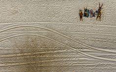 People sunbathe at Barra da Tijuca beach in Rio de Janeiro, Brazil