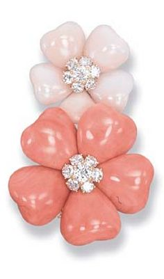 A CORAL 'APHRODITE' BROOCH, BY VAN CLEEF & ARPELS Designed as a pink and red coral floral brooch with diamond cluster centres, 5.7 cm. long, with French assay mark for gold, in blue leather Van Cleef & Arpels box Signed Van Cleef & Arpels, no. M41326 <3