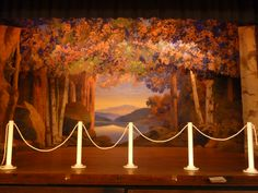 Maxfield Parish stage set in Plainfield Town Hall, New Hampshire. Artist Maxfield Parrish was a resident of Plainfield for sixty-eight years and a member of the Cornish Art Colony. In 1916, William Howard Hart commissioned Parrish to design a stage set for the Town Hall. Parrish painted a woodland scene with a lake (or the Connecticut River) and Mount Ascutney, Vermont, in the center. The design was used for the stage back-drop, six wings, and three overhead drapes.