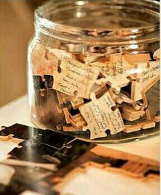 Take an engagement picture, put it on a wooden puzzle, and have it put together upside down for guests to write on as your guestbook - functional and fun! :)