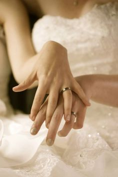 I love this picture of two brides showing off their matching #wedding #rings for a lesbian wedding.