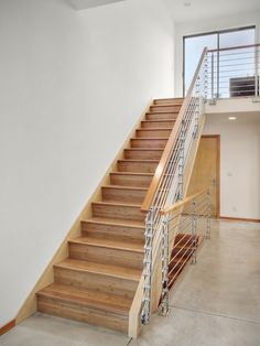 scandinavian staircase with brown wooden