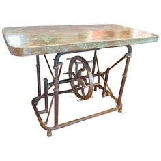 Unusual Industrial Steel Table With Patinated Copper Top. Made of steel with a wheeled Mechanism to raise and lower the top. This can be used as a coffee table, dining table ,bar, or sofa table. Mechanical base made in Pennsyvania circa 1910 ( Copper top later)  Similar style available at Hastenings Gallery in Middleburg, Virginia. Feel free to come in and check out more of Louis Shields inventory!
