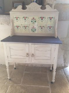 Old wash stand painted in cream chalk paint, distressed plain waxed then washed with dark wax on top for zen ages look