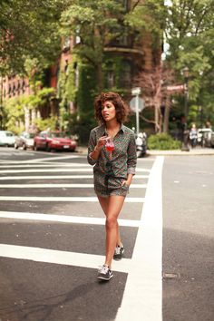 Browse the best summer street style outfit ideas at @stylecaster | 'Trop Rouge' blogger in printed romper, Nike sneakers