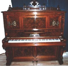 piano- i like this color too and the thing at the top. kind of elaborate. the sisters are wealthier than most families I believe, would probably have a fancier piano